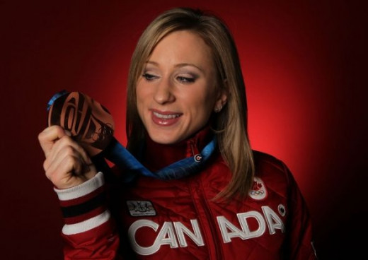 Canadian Joannie Rochette posing with her bronze medal won for figure skating at the 2010 Olympics.