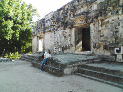 Me sitting on the lower jaw between the teeth at Chicaná