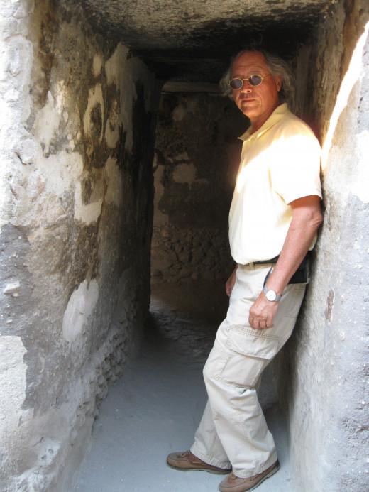 Alejandro in a passageway at Mitla