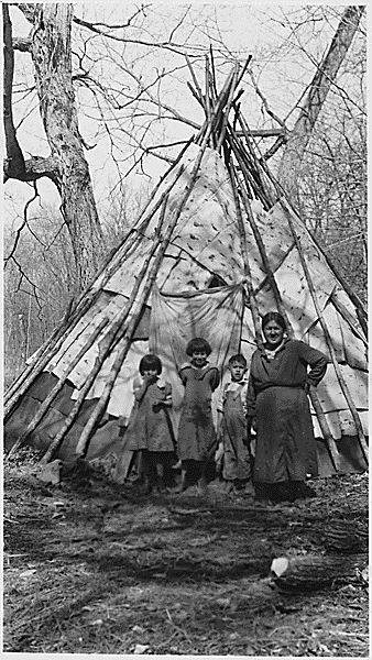 Indian Woman and Children in Front of Teepee