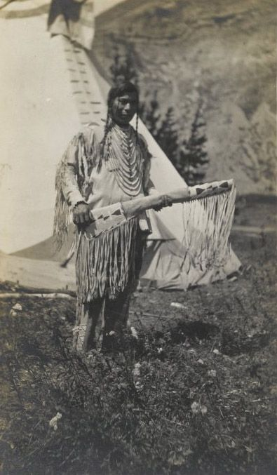 Native American Chief Standing Beside Teepee