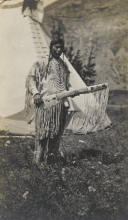 Native American Chief Standing Beside Teepee