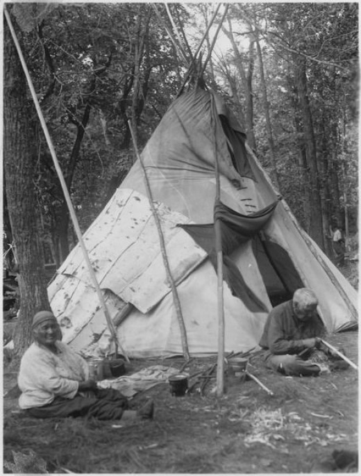 Rabit and His Wife Sit in Front of Teepee