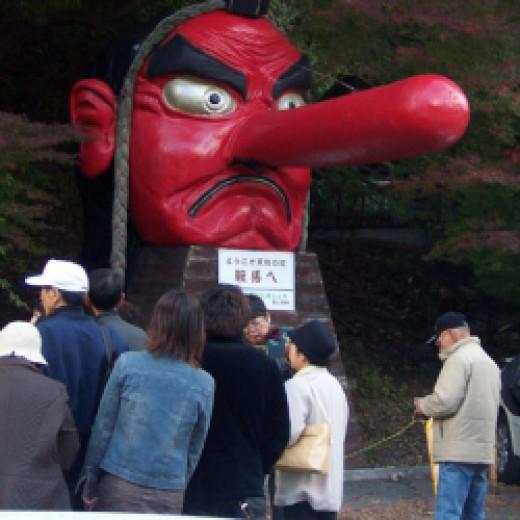 Giant tengu mask in front of Yuki shrine, Creative Commons 2.0 generic license