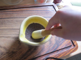 Grinding the seed mix in a pestle and mortar.