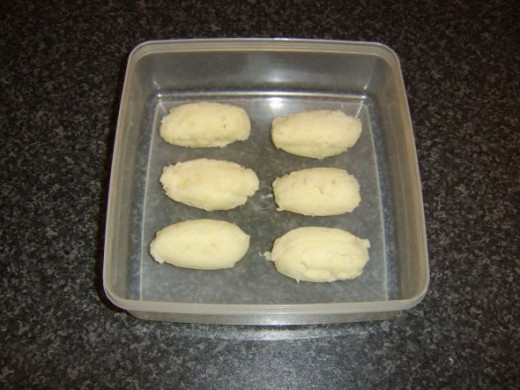 Croquette shaped mashed potatoes ready to be refrigerated