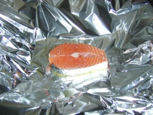 Preparing the salmon steak for baking