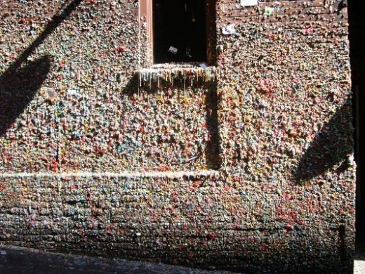 "The ""Gum Wall"" was started by people waiting in line to attend an event at the Pike Place Theater. Yes, it is millions of pieces of chewing gum in all different colors. CNN listed it as one of its ""germiest places in the world"", in second place behin"