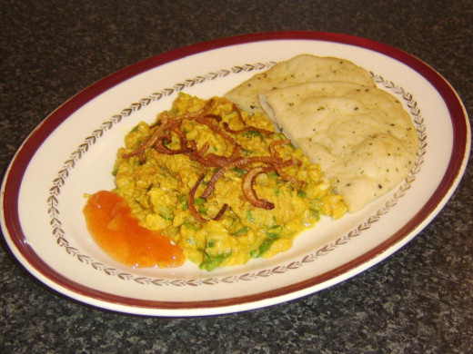 Eggs scrambled with onion, green chilis, cilantro and turmeric are served with naan bread and mango chutney