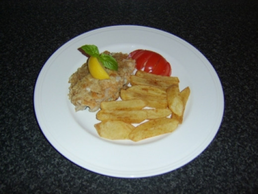 Coley fillet is shallow fried in fresh breadcrumbs and served with homemade chips