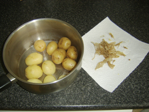 Skin is carefully peeled from cooled potatoes