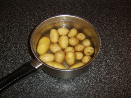 Potatoes are initially added to cold water