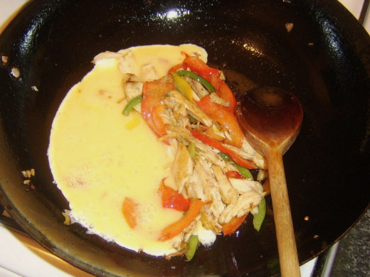 Beaten egg is added to turkey and bell pepper