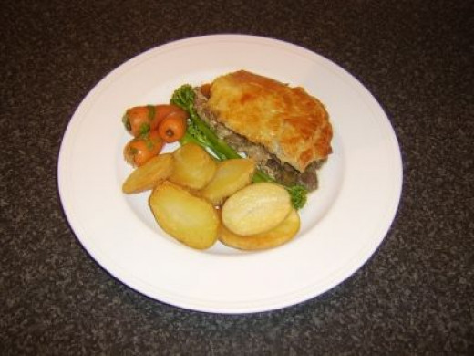 Guinea fowl and venison game pie with trimmings