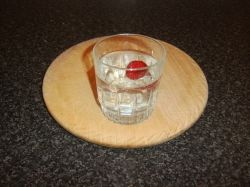 Gin and tonic with frozen strawberry