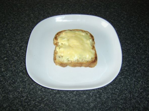 Cheese melted over egg and cress