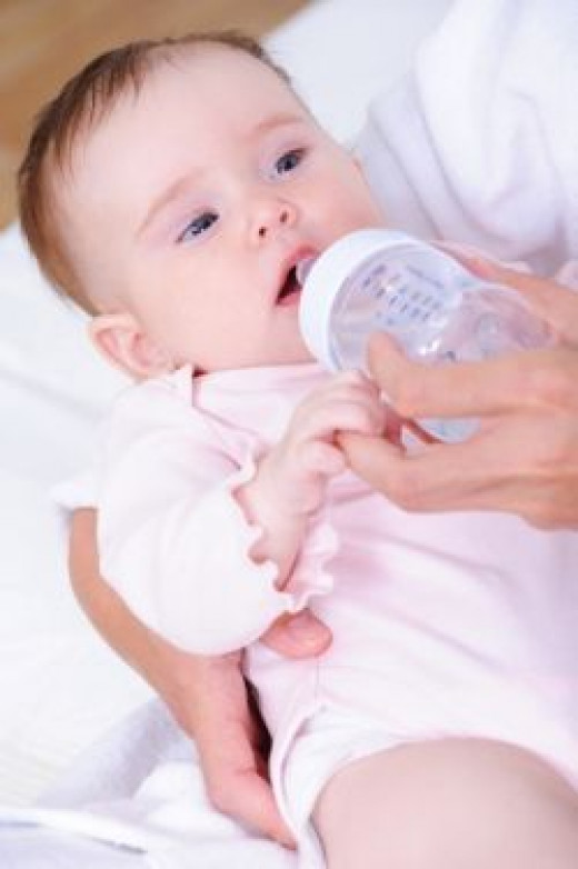 Baby Fed From Plastic Bottle