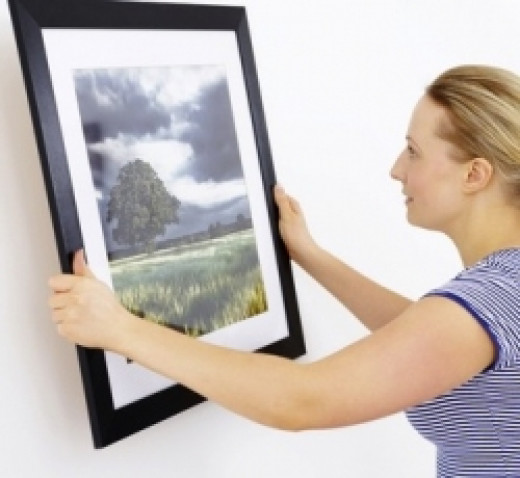 Arranging and hanging pictures on a wall
