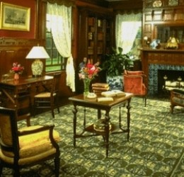 """Rug shown above is """"Poppy"""" by Axminster carpet, designed by William Morris in 1875 as it is used in the library of the Lyman Estate in Waltham, Massachusetts. Photographed by Kevin Latady. Used with permission."""