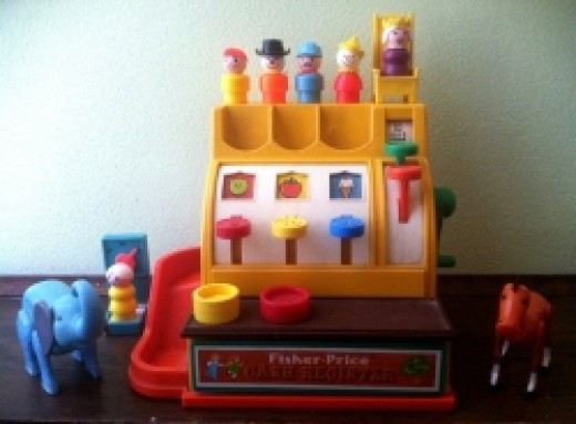 This Fisher Price cash register is one of my absolute favorite toys.  I used it for so many things.  I used it as a bank, as a cash register at my mom's rummage sale, and pretended like I was at a real store doing grown up shopping.
