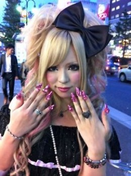 A Gyaru showing off her intricate manicured nails.