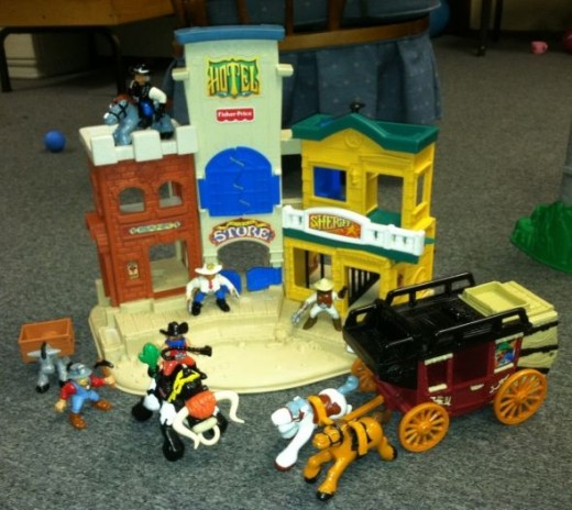 The Fisher Price Western Town and everything including a stage coach!