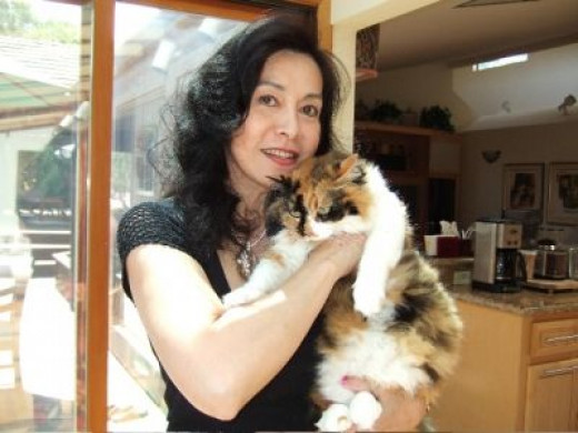 """That's me looking grumpy with my momma in 2009. Cats just do not know how to """"say cheese."""""""