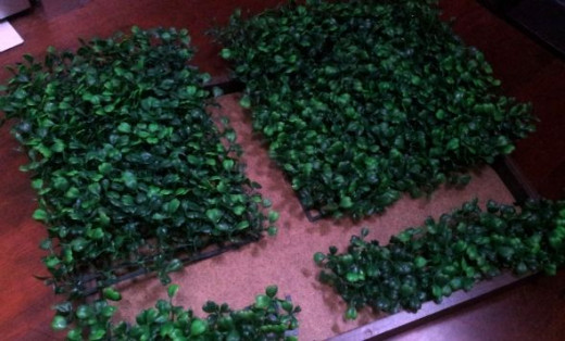 Cut the grass mats to size to fit in the frame