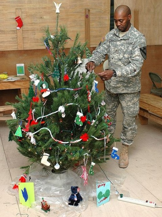 Soldier decorating Christmas Tree