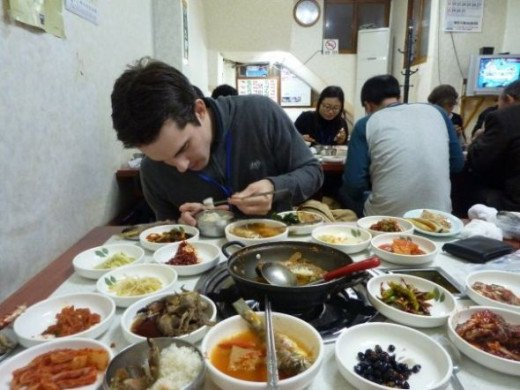 A typical meal of fish and many different side dishes to share.