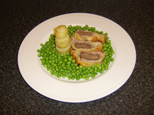 Beef Wellington with Potato and Parsnip Tower and Peas Recipe