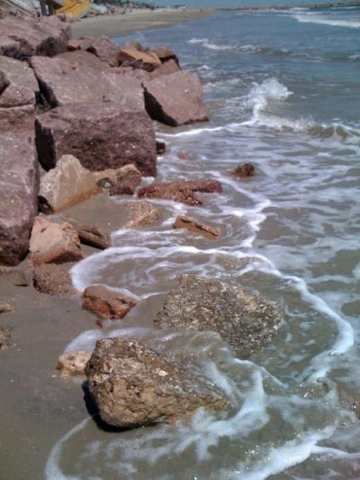 A day spent on Galveston Island's beach with lace waves and rocks.