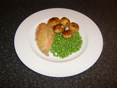 Breast of Roast Chicken with Roast Potatoes and Garden Peas