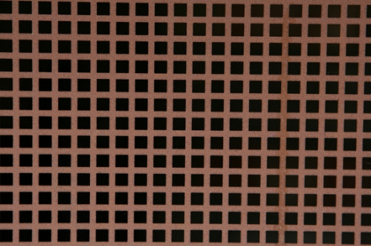 Not all Hermann grids produce the same scintillation effect, but the black dots still appear in a regular Hermann grid illusion. Source: Richard Cocks, Flickr.