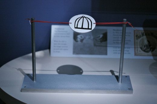 Marcin Wichary's photo of the bird cage thaumatrope reveals one way they were used. Source: Marcin Wichary, Flickr.