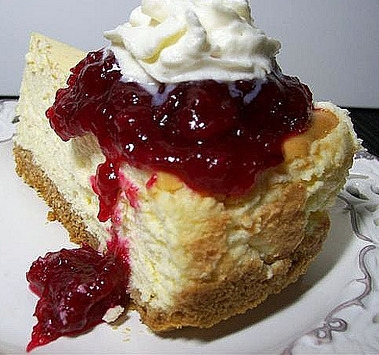 One piece of cranberry cheesecake with whipped cream