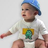 Baby Bodysuit. Three bottom snaps. Standard T-shirt neck. Sizes: 6mo, 12mo, 18mo, 2T. Colors: White, Pink, Baby Blue