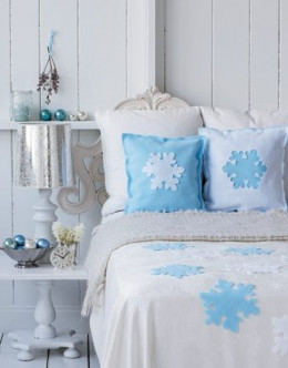 Transform your bedroom with some simple felt throw pillows and snowflake cutouts. Hot-glue snowflakes to a simple white matelasse, or use a slip stitch to gently attach them to your bedspread for the holiday season.By www.countryliving.com
