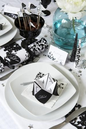 Black Christmas decorations and black and white (after dark) themed dinner table decorations and accessories, from crackers and place cards, to dinner games and party poppers.By www.soraiseyourglasses.com