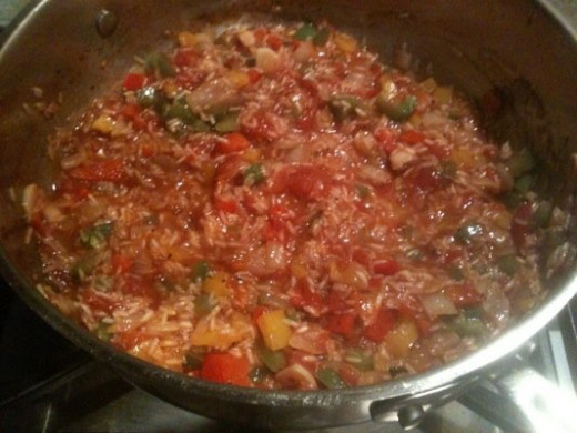 At this point I've added the rice, tomatoes and seasonings.