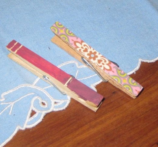 My grandson painted the red clothespin, and I covered the other clothespin with scrapbook paper. This is just one example of an easy clothespin craft project.