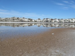 A pond on the 16 mile circle route in White Sands National Monument - the geology of the pond is the same as that of the much larger Lake Lucero .