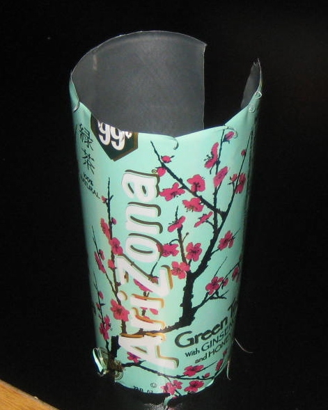 Cut off top and bottom of can with scissors!