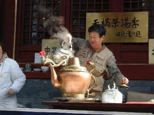 The tea soup seller has a dragon pot which he keeps refilling.  This way you can get the water for your soup poured into your bowl by the dragon!