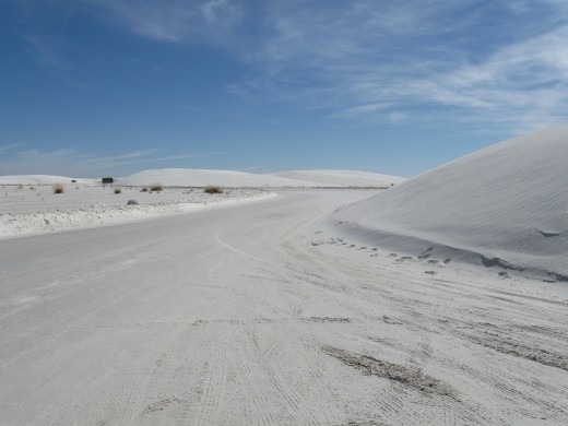 That is white sand, not SNOW, on the road ahead. White Sands National Monument, NM