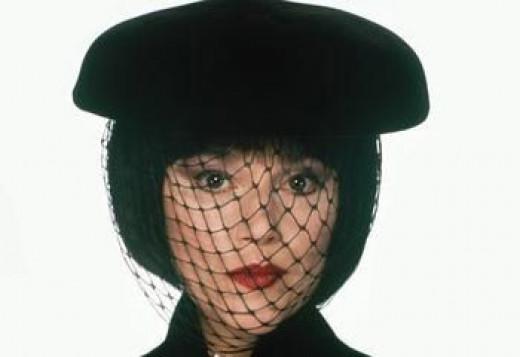 Madeline Kahn as Mrs. White