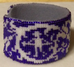 I decided to put this cuff on an aluminum cuff bracelet blank.  This is the left side of the bracelet with a hunter and a spear.