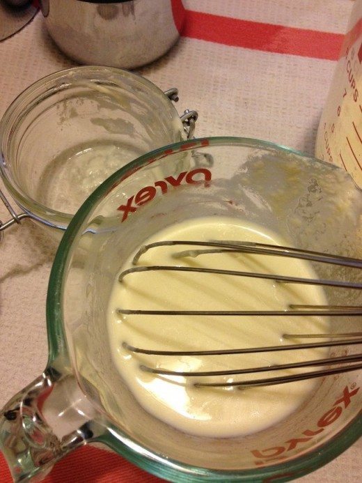 Lightly whisking a small amount of warm milk with the culture