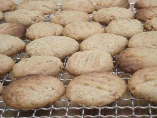 Cookies Cooling On Rack, subtly bursting with walnuts..