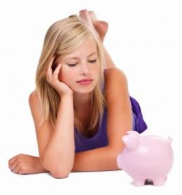 Youn Girl With Piggy Bank (Photo By Shutterstock/Yuri Arcurs)